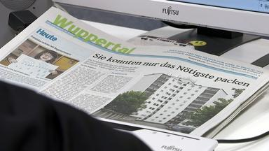 Zeitungsartikel über Hochhausräumung