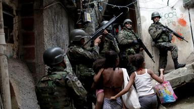 soldiers take up a position during an operation after violent clashes between drug gangs in rocinha slum in rio de janeiro