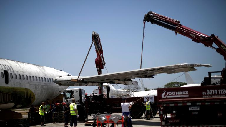 german technicians from lufthansa tecnik dismantle the boeing 737-200 at the fortaleza international airport