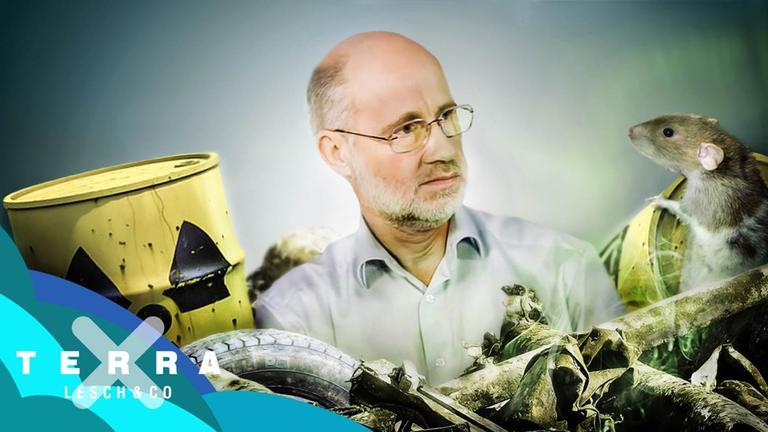 Harald Lesch zwischen Atommüllfässern und einer Ratte