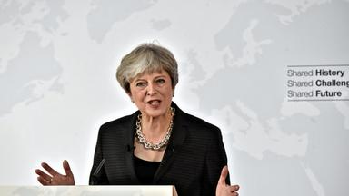 british prime minister may delivers her speech in florence