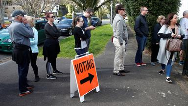 voters wait outside a polling station at the st heliers tennis club during the general election in auckland
