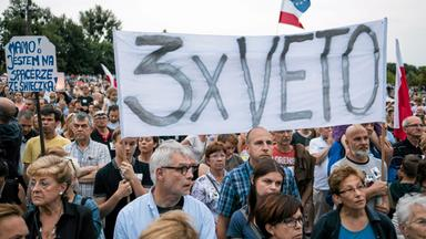 people gather during a protest against the supreme court legislation in poznan
