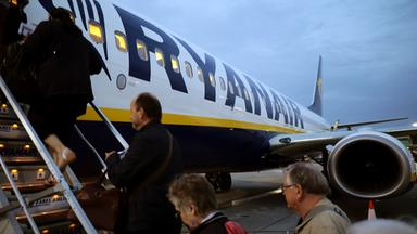 people board a ryanair flight at stansted airport, northeast of london, britain